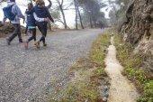 Family walking by Caminito del Rey path