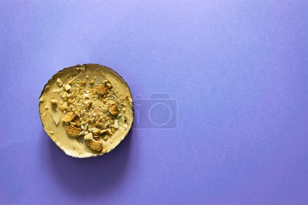 Photo for Sweet tart with cream and cookies on purple background. Lat lay, copy space. - Royalty Free Image