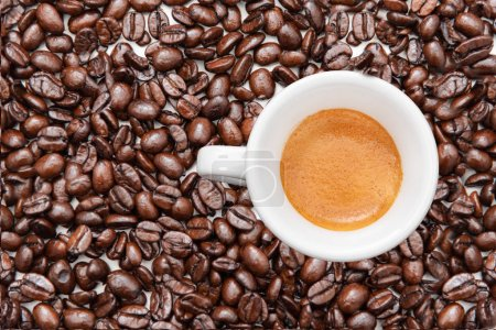 Photo for Flat lay cup of espresso coffee and whole roasted beans on background, copy space. - Royalty Free Image