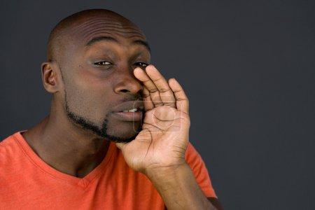 african american man talking, whispering