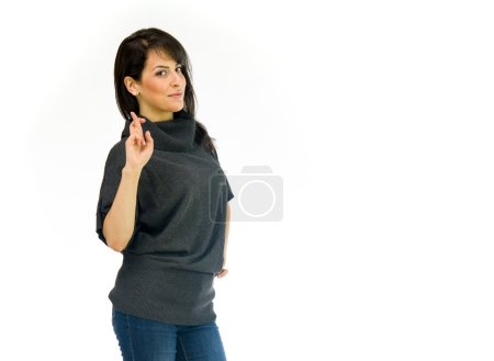 Casual woman with fingers crossed for luck