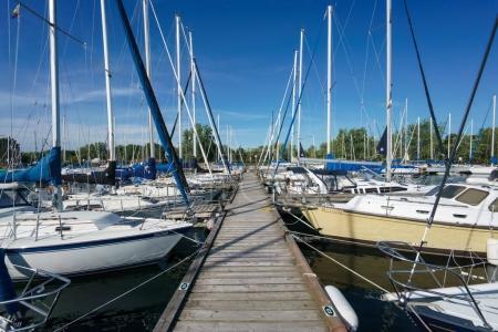 Stationary sailing boat alongside pier