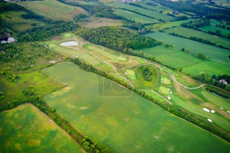 High angle view of golf course amongst fields
