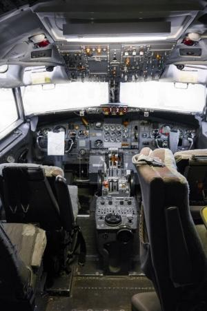 High angle view of cockpit of old, stationary aeroplane