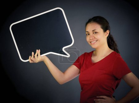 woman looking at camera holding speech bubble