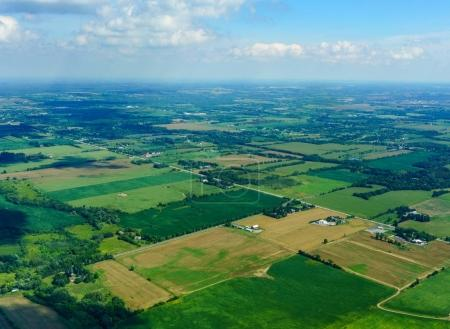 Aerial view at daytime of agricultural land