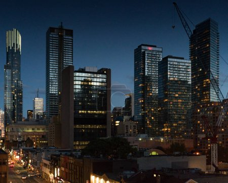 Photo for Cityscape at dusk, modern skyscrapers with illuminated windows and Ontario, Canada - Royalty Free Image