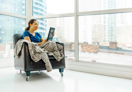 Woman using digital tablet.