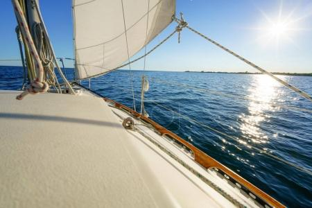 Photo for Looking out to sea at horizon, from sailboat, sunny day - Royalty Free Image