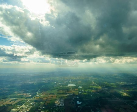 Aerial view of clouds high in the sky and landscape below