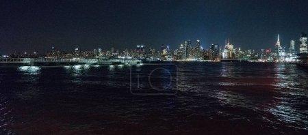 Photo for View of New York city illuminated at night, New York, USA - Royalty Free Image