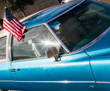 Shiny blue car with American flag