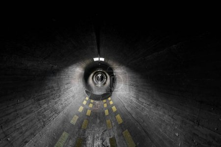 Photo for View through dark grey tunnel with diminishing perspective, and eerie lighting. - Royalty Free Image