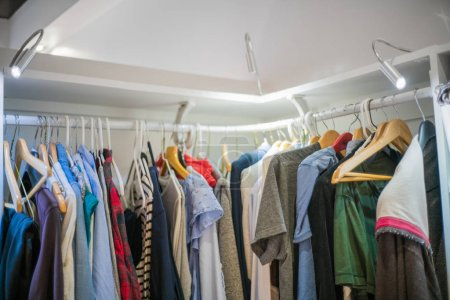 Clothes on hanger in closet
