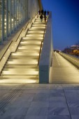 Low angle view of group of people climbing illuminated staircase at Stavros Niarchos Foundation Cultural Center, Athens, Greece