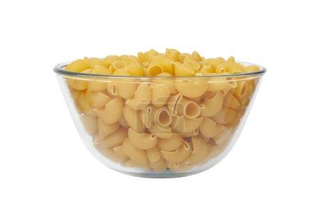 Photo pour Tuyauterie pour pâtes alimentaires Rincez dans une tasse de verre. Isolé sur fond blanc. Avec chemin de coupe. - image libre de droit