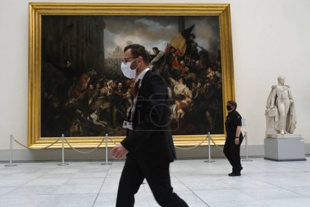 Photo for Security guards walk in the  the Royal Museum of Fine Arts at the first day of reopening amid the coronavirus crisis in Brussels, Belgium, 19 May 2020. - Royalty Free Image