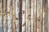 Dřevěné textury pozadí v vertikální hnědé latě a sucích