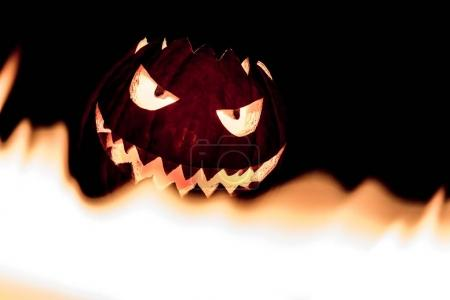 The big helloween symbol has a mad face glowing ey...
