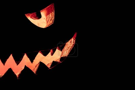 Big spooky helloween symbol has a glowing mad face...