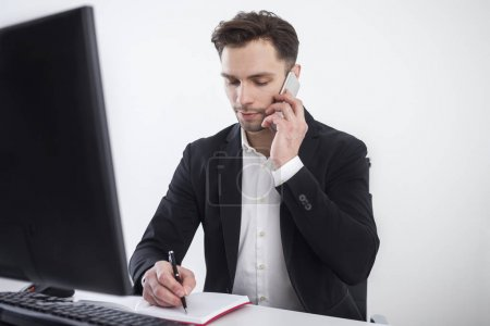 Concentrated businessman on the phone