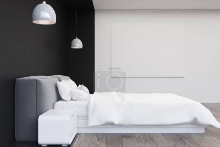 Black and white bedroom with a poster