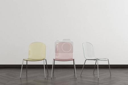 Transparent chairs in an empty room