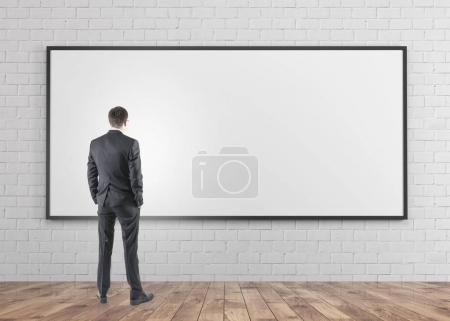 Businessman looking at whiteboard
