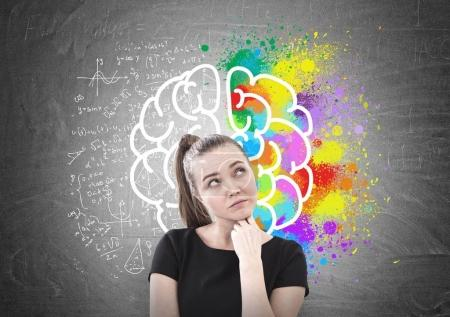 Pensive woman in T shirt, brain