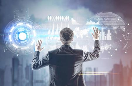 Businessman with hands in the air, HUD city