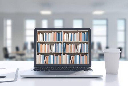 Laptop with bookshelves on screen, office, coffee
