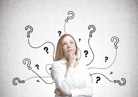Dreamy blonde businesswoman, questions