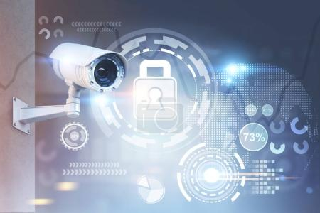 Photo for Modern CCTV camera on a wall. A blurred background with an abstract infographics and security HUD. Toned image double exposure mock up - Royalty Free Image