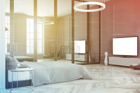 Photo for Gray bedroom interior with a wooden floor, a master bed with a lamp hanging above it, a TV set, and large windows. 3d rendering mock up toned image - Royalty Free Image