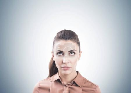 Pensive woman in brown, gray