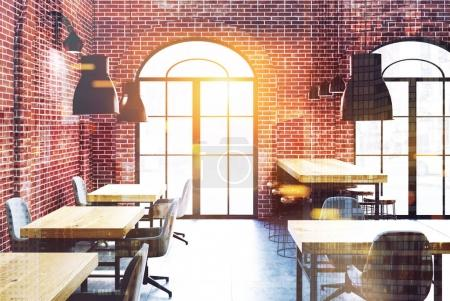 Brick cafe, wooden tables toned