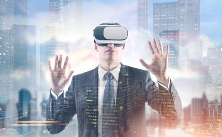 Businessman in VR glasses, morning city