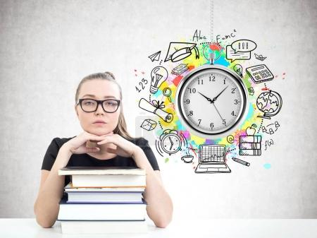 Serious blonde student, books, time and schedule