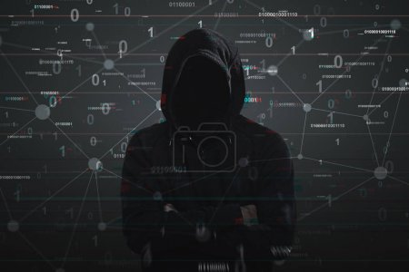 Photo for Portrait of an unrecognizable hacker wearing a black hoodie and standing with crossed arms. Black background with a binary code. Double exposure - Royalty Free Image