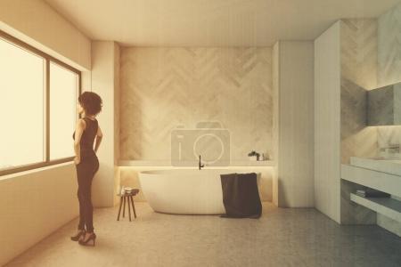 White wooden bathroom, round tub, woman