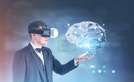 Businessman in VR glasses showing a brain hologram