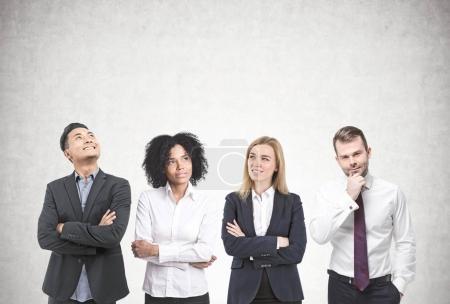 Diverse business team brainstorming, concrete
