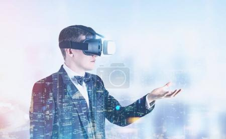 Businessman in VR glasses in a night city