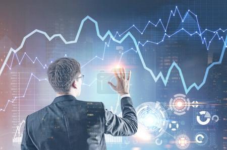 Young businessman, HUD hologram, graph