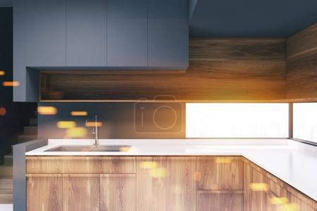 Gray kitchen with wooden countertops toned