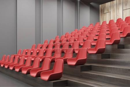Cinema interior corner, red chairs, gray