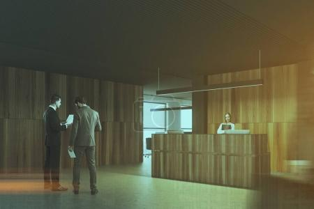 Wood and black office reception side view toned