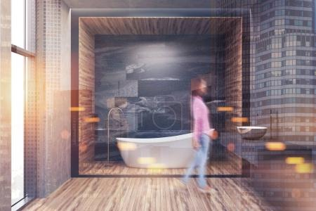 Gray, wooden and marble bathroom toned