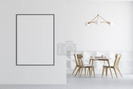 White dining room, wooden chairs, poster on wall