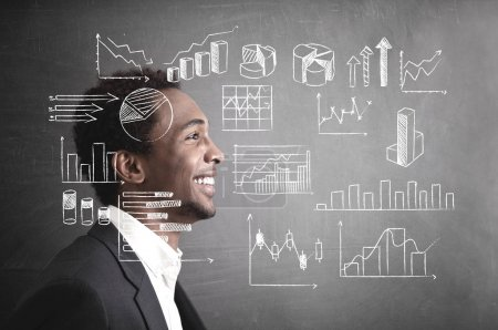 Cheerful African American businessman, side, graph